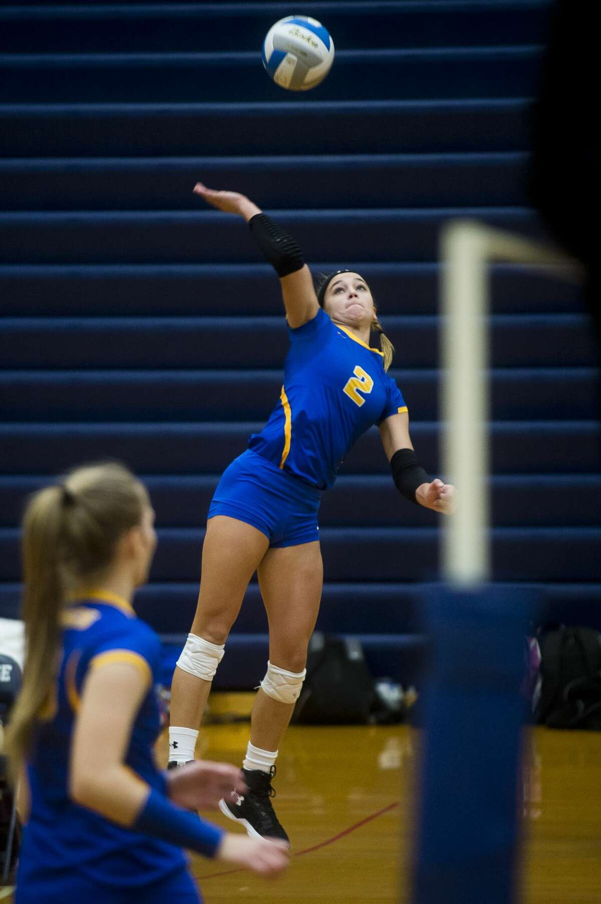 Midland senior Peyton Gerstacker spikes the ball during the Chemics' Class A state quarterfinal match against Bloomfield Hills Marian on Tuesday, Nov. 14, 2017 at Saginaw Heritage High School. The Chemics lost to the Mustangs 3-0. (Katy Kildee/kkildee@mdn.net)