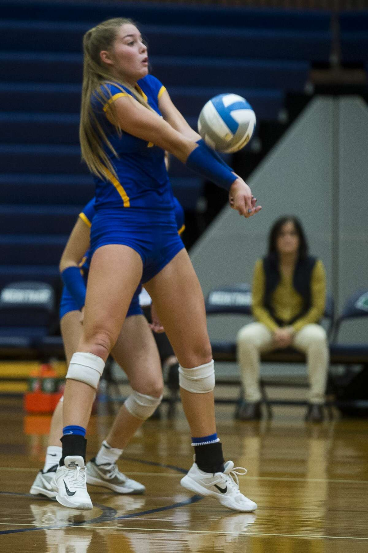 Midland senior Grace Rekeweg bumps the ball during the Chemics' Class A state quarterfinal match against Bloomfield Hills Marian on Tuesday, Nov. 14, 2017 at Saginaw Heritage High School. The Chemics lost to the Mustangs 3-0. (Katy Kildee/kkildee@mdn.net)