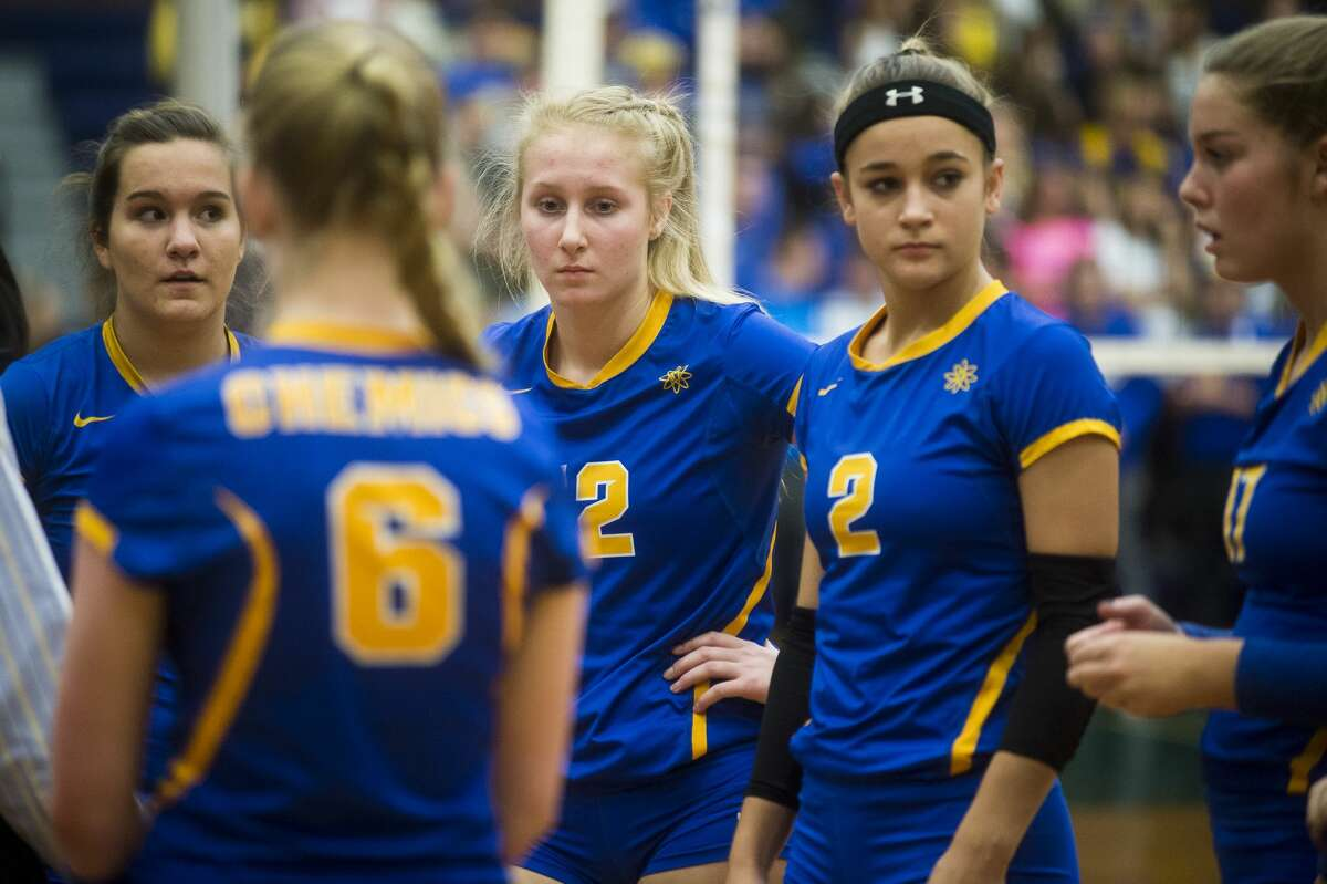 From left, Midland senior Alexandria McMath, junior Maya Albright, senior Peyton Gerstacker and senior Grace Rekeweg react to losing the first set during the Chemics' Class A state quarterfinal match against Bloomfield Hills Marian on Tuesday, Nov. 14, 2017 at Saginaw Heritage High School. The Chemics lost to the Mustangs 3-0. (Katy Kildee/kkildee@mdn.net)