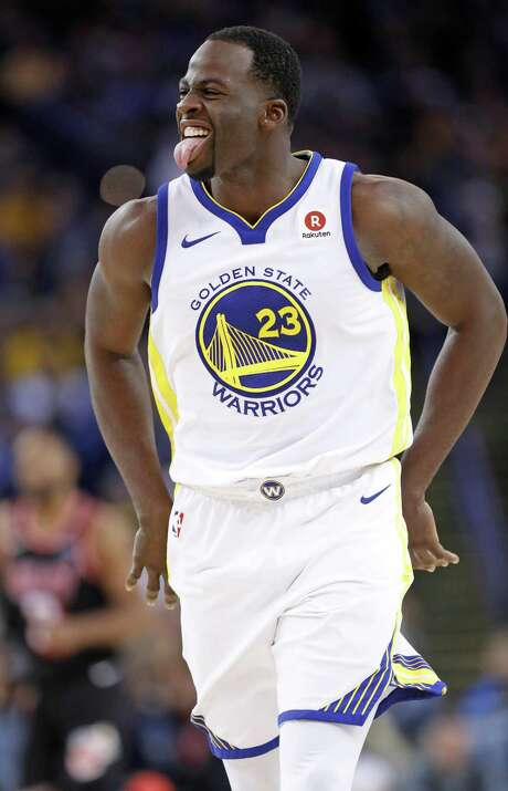 Golden State Warriors' Draymond Green reacts to making a 3-pointer in 4th quarter against Miami Heat during Warriors' 97-80 win in NBA game at Oracle Arena in Oakland, Calif., on Monday, November 6, 2017. Photo: Scott Strazzante / The Chronicle / San Francisco Chronicle