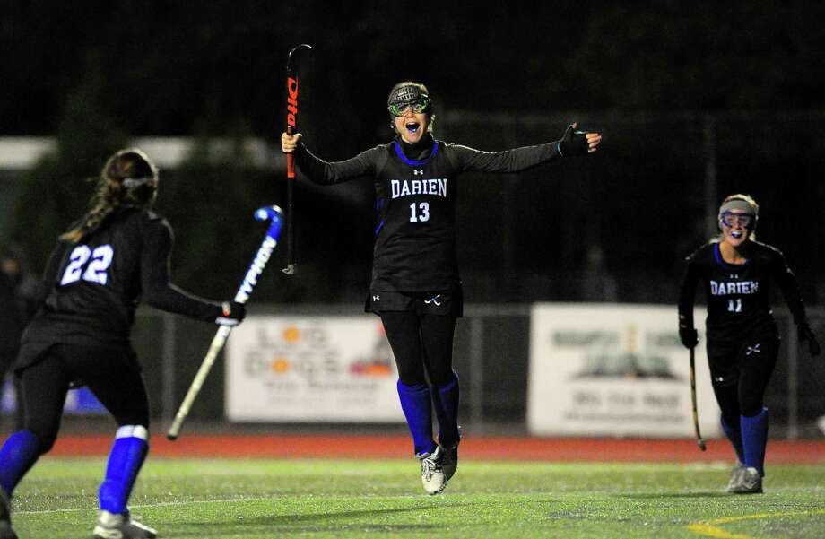 Darien's Bridget Mahoney leaps into the air to celebrate after getting a goal during CIAC Class L field hockey semifinal action in Cheshire, Conn. on Tuesday November 14, 2017. Mahoney was assisted by teammate Kiki Tropsa from a penalty corner. Photo: Christian Abraham / Hearst Connecticut Media / Connecticut Post