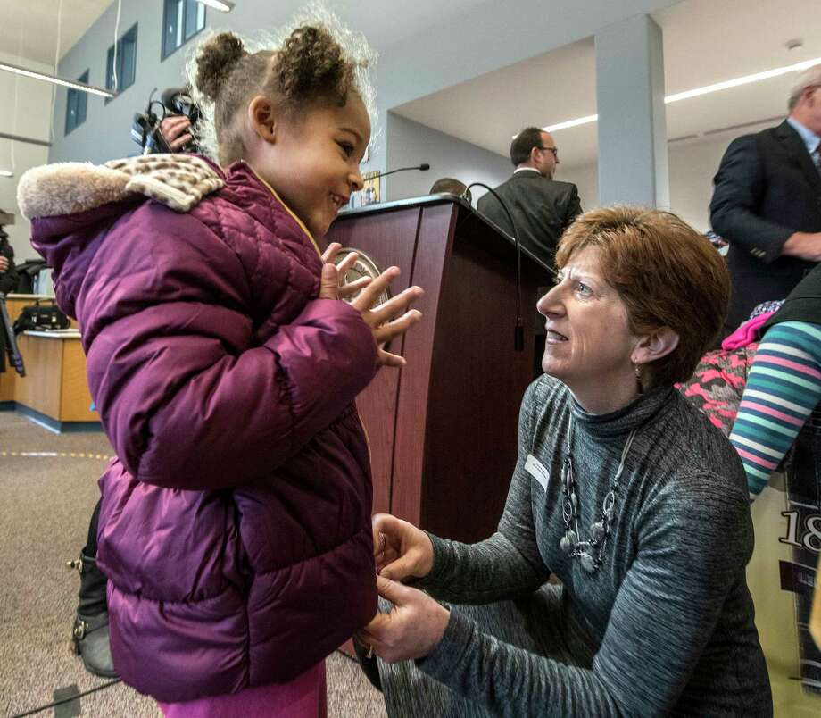Albany Mayor Kathy Sheehan, right, assists with fitting a donated coat on Anastasia Moore, 5, at the North Albany Academy on Tuesday, Nov. 14, 2017, in Albany, N.Y.  (Skip Dickstein/ Times Union) Photo: SKIP DICKSTEIN / 20042135A