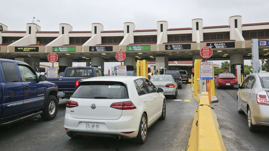 Vehicles entering the U.S. from Nuevo Laredo wait in line at the Ready Lanes at Lincoln Juarez International Bridge on Saturday morning. As part of an outreach effort to encourage Ready Lane compliance, Saturday, U.S. Customs and Border Protection (CBP) handed out Ready Lane flyers and referred Ready Lane passengers that do not utilize radio-frequency identification technology (RFID)-enabled entry documents to an informational booth at their secondary inspection area. Photo: Victor Strife, Photographer / LAREDO MORNING TIMES