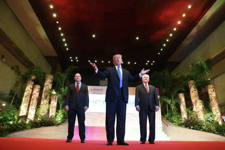 President Donald Trump, center,  gives a statement before leaving for the airport, an East Asia Summit at the Philippine International Convention Center, Tuesday, Nov. 14, 2017, in Manila, Philippines. Secretary of State Rex Tillerson is seen at right while National Security Adviser H.R. McMaster is at left. At right is Rex Tillerson and Trump is on a five country trip through Asia traveling to Japan, South Korea, China, Vietnam and the Philippines. (AP Photo/Andrew Harnik) Photo: Andrew Harnik, STF / Copyright 2017 The Associated Press. All rights reserved.