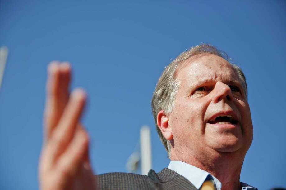 Alabama Democrat Senate candidate Doug Jones speaks to the media Tuesday in Birmingham, Ala. A victory by Jones against Roy Moore would cut the GOP Senate majority to an unwieldy 51-49. Photo: Brynn Anderson, STF / Copyright 2017 The Associated Press. All rights reserved.