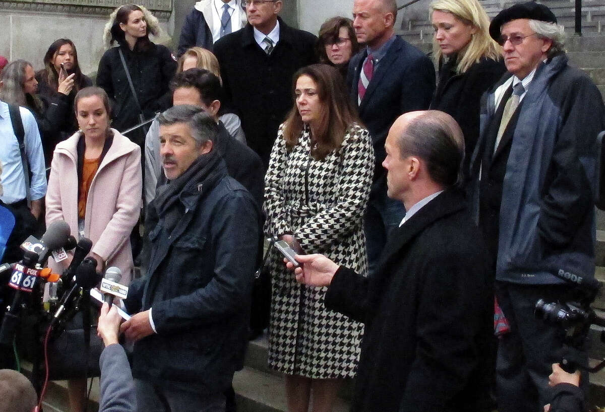 Ian Hockley, front left, father of Dylan Hockley, one of the children killed in the 2012 Sandy Hook Elementary School shooting, speaks outside the Connecticut Supreme Court Tuesday, Nov. 14, 2017, in Hartford, Conn., following an appeal hearing on whether gun maker Remington Arms should be held liable for the 2012 school massacre at Sandy Hook Elementary School in Newtown, Conn. A survivor and relatives of nine people killed in the shooting are trying to sue the North Carolina company that made the AR-15-style rifle used to kill 20 first-graders and six educators at the school in Newtown, Conn. A lower court dismissed the lawsuit. (AP Photo/Dave Collins)