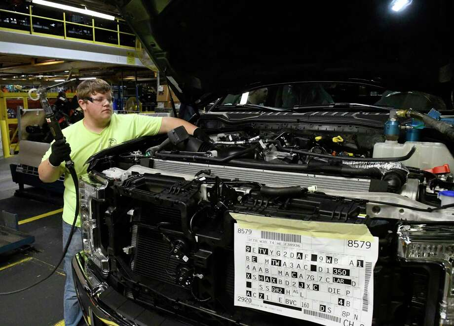 A worker helps assemble a truck at a Ford plant in Louisville, Ky. Producer prices rose faster than expected in October.  Photo: Timothy D. Easley, FRE / FR43398 AP