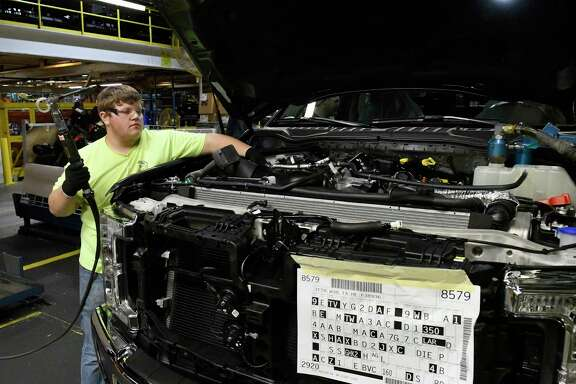 A worker helps assemble a truck at a Ford plant in Louisville, Ky. Producer prices rose faster than expected in October.