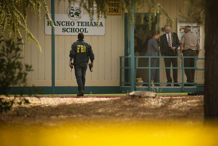 FBI agents are seen behind yellow crime scene tape outside Rancho Tehama Elementary School after a shooting in the morning on November 14, 2017, in Rancho Tehama, California Four people were killed and nearly a dozen were wounded, including several children, when a gunman went on a rampage at multiple locations, including a school in rural northern California. Photo: ELIJAH NOUVELAGE, AFP/Getty Images