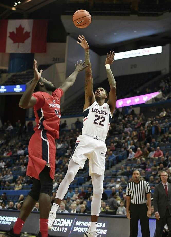 UConn's Terry Larrier shoots over Stony Brook's JuniorSaintel during Tuesday's game in Hartford. Photo: Jessica Hill / Associated Press / AP2017