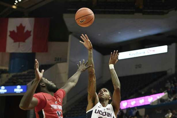UConn's Terry Larrier shoots over Stony Brook's Junior Saintel during Tuesday's game in Hartford.