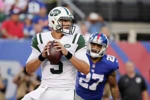 FILE - In this Aug. 26, 2017, file photo, New York Jets quarterback Christian Hackenberg (5) looks to pass during the first half of a preseason NFL football game against the New York Giants in East Rutherford, N.J. Hackenberg remains a big mystery for the New York Jets. The second-year quarterback has yet to take a snap in a regular-season game, and it appears he won't get an opportunity any time soon. Hackenberg is the Jets' No. 3 quarterback, stuck behind backup Bryce Petty and 38-year-old starter Josh McCown. (AP Photo/Julio Cortez, File) ORG XMIT: NY192
