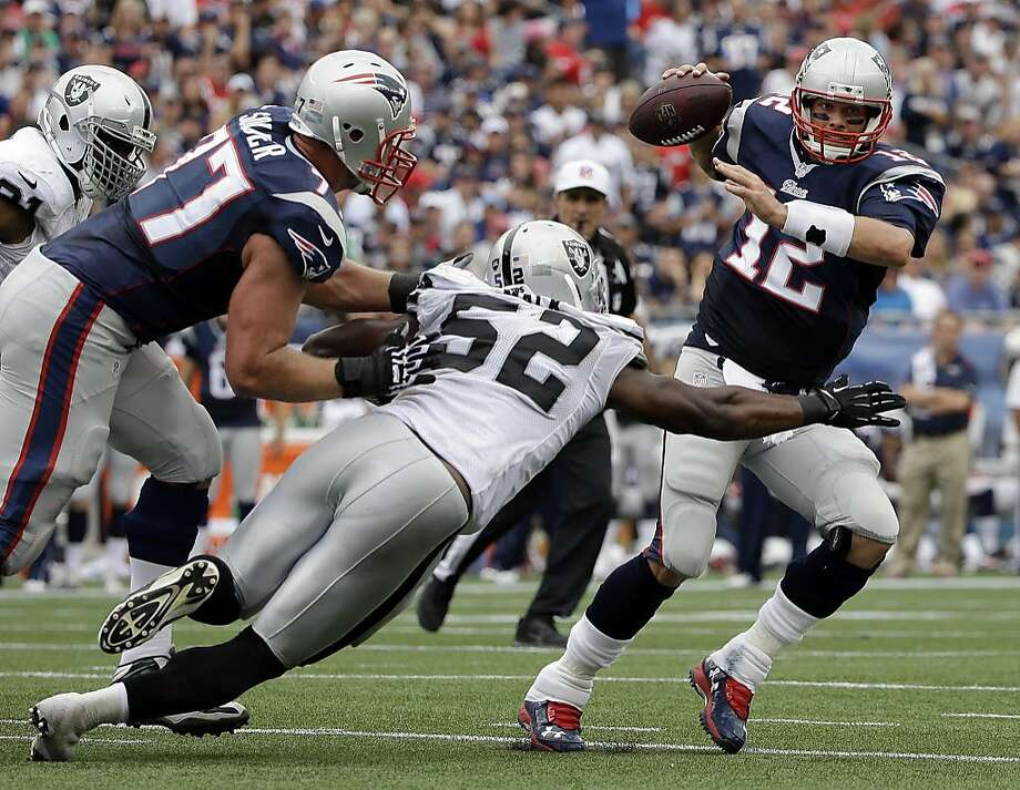 Oakland Raiders outside linebacker Khalil Mack (52) pressures New England Patriots quarterback Tom Brady (12) in the first half of an NFL football game Sunday, Sept. 21, 2014, in Foxborough, Mass. (AP Photo/Steven Senne) Photo: Steven Senne, Associated Press