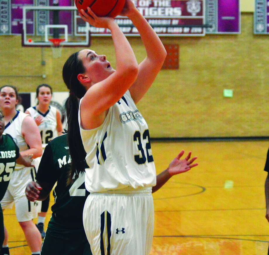 Father McGivney forward Madison Webb scores two of her game-high 19 points in the first quarter of Tuesday's victory over Madison in the Dupo Cat Classic.