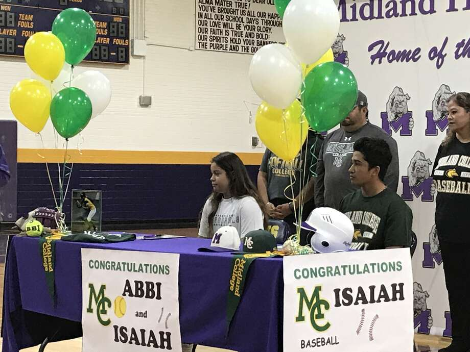 Midland High's Abbi Sanchez and Isaiah Baeza at Tuesday's signing ceremony at the Midland High gym.