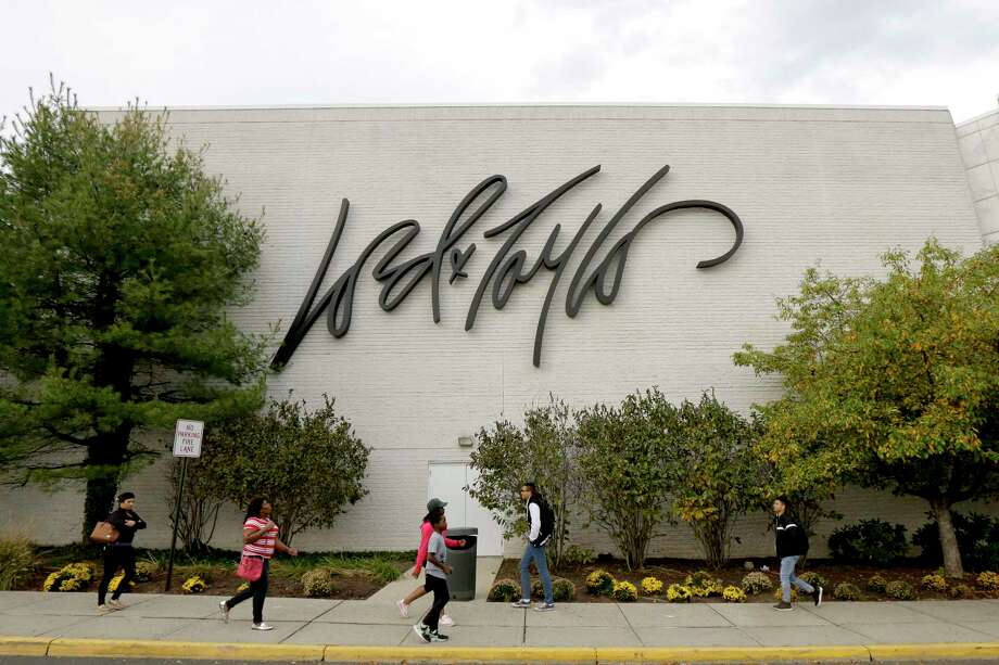 FILE - In this Wednesday, Oct. 25, 2017, file photo, people walk on a sidewalk along the entrance to Lord & Taylor department store at Garden State Plaza in Paramus, N.J. Walmart announced Monday, Nov. 13, 2017, that it will devote a section on its website to upscale Lord & Taylor, the latest strategic partnership as retailers make alliances. (AP Photo/Julio Cortez, File) ORG XMIT: NYBZ152 Photo: Julio Cortez / Copyright 2017 The Associated Press. All rights reserved.