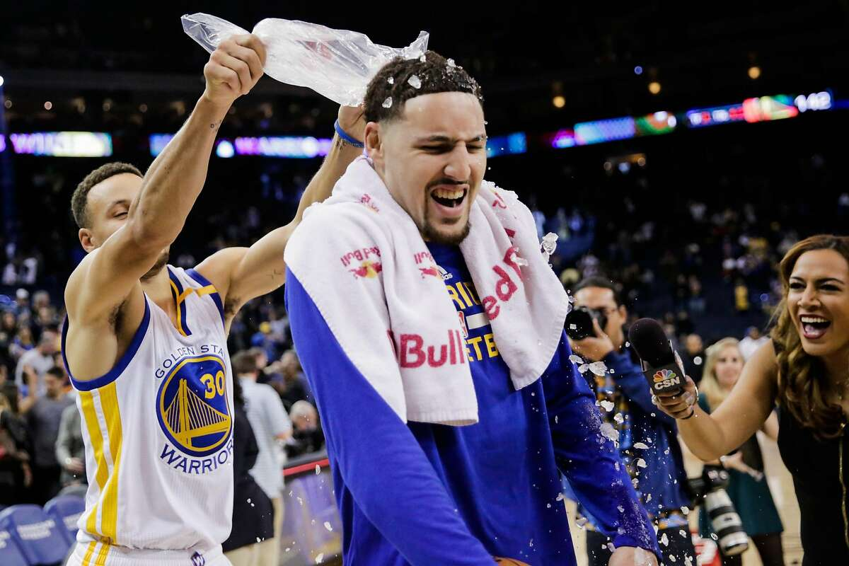 Golden State Warriors' Stephen Curry, #30 pours ice on teammate Klay Thompson, #11, after Klay scored a personal record of 60 points in a game against the Indiana Pacers, in Oakland, California, on Monday, Dec. 5, 2016.