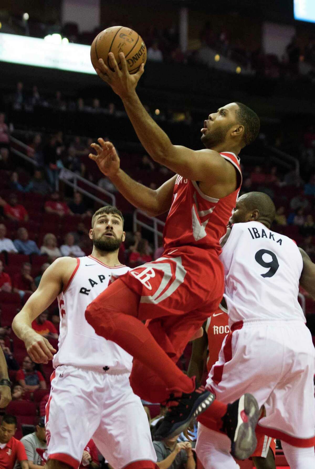 Houston Rockets guard Eric Gordon (10) drives to the basket scoring during the first quarter against the Toronto Raptors, Tuesday, Nov. 14, 2017, in Houston.