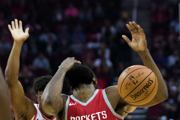 Houston Rockets guard James Harden (13) reacts after being hit on the face during the first half while playing against the Toronto Raptors, Tuesday, Nov. 14, 2017, at the Toyota Center in Houston.