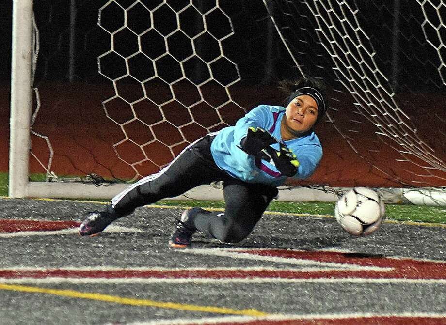 Weston goalkeeper Jaylin Ferguson dives to make one of her 10 saves during her team's 3-2 loss to Granby in a Class M semifinal Tuesday. Photo: John Nash / Hearst Connecticut Media