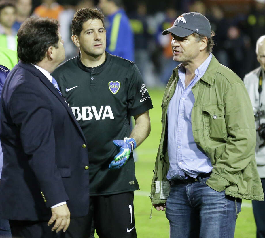 FILE - In this May 14, 2015, file photo, CONMEBOL delegate Roger Bello, of Bolivia, left, talks with Boca Juniors goalkeeper Agustin Orion, center, and Alejandro Burzaco, president of Torneos y Competencias, during a Copa Libertadores soccer match between Boca Juniors and River Plate, in Buenos Aires, Argentina. Burzaco, the former CEO of a marketing firm based in Argentina, testified Tuesday, Nov. 14, 2017, at the U.S. trial of three former South American soccer officials accused of taking bribes in a sprawling corruption investigation of FIFA,  that Fox was among several media companies paying bribes through sham contracts for the Copa America and other events. (AP Photo/Victor R. Caivano, File) Photo: Victor R. Caivano, STF / Copyright 2017 The Associated Press. All rights reserved.