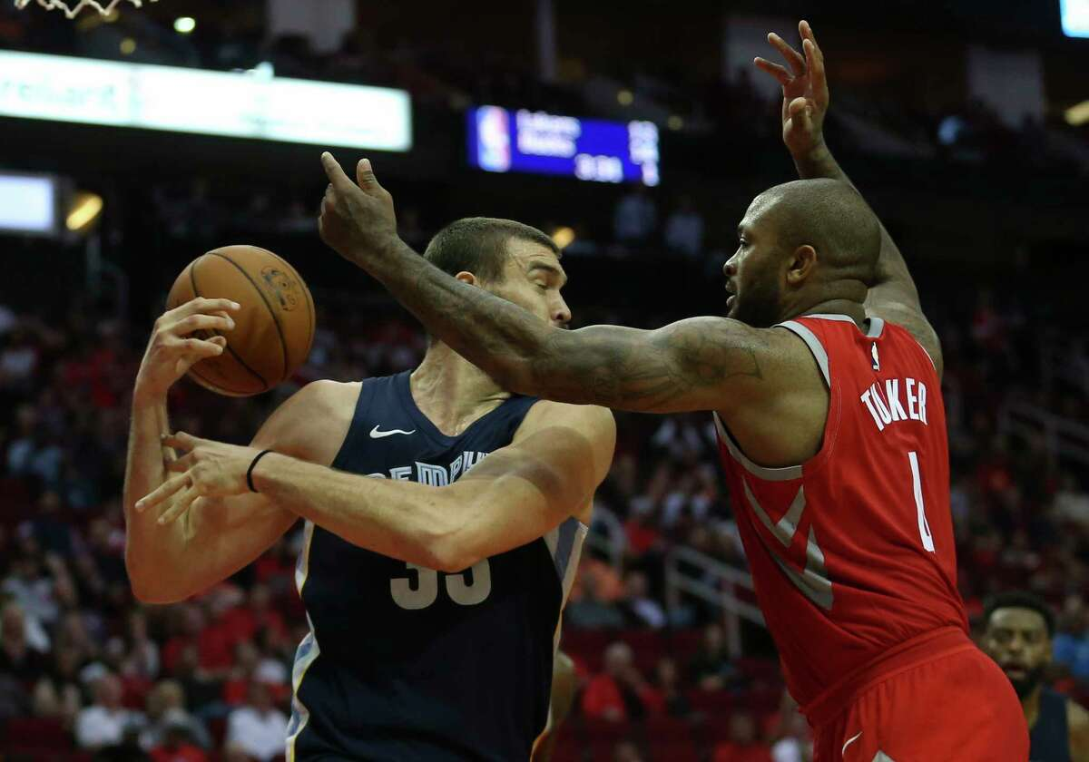 Rockets forward P.J. Tucker, right, is not afraid to mix it up with much bigger players.