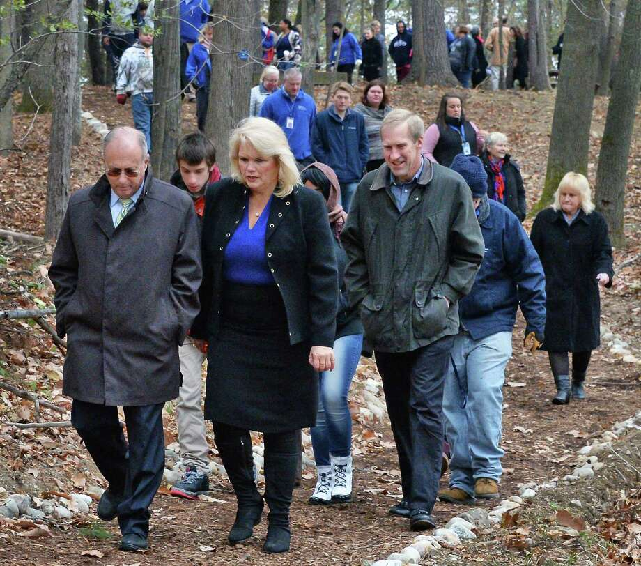CDPHP CEO Dr. John Bennett, left, and Mark Warner, right, of the Hudson-Mohawk Road Runners Club, join Vanderheyden CEO Karen Carpenter Palumbo to walk their new Sanctuary Trail Tuesday Nov. 14, 2017 in Wynantskill, NY.  (John Carl D'Annibale / Times Union) Photo: John Carl D'Annibale / 20042109A