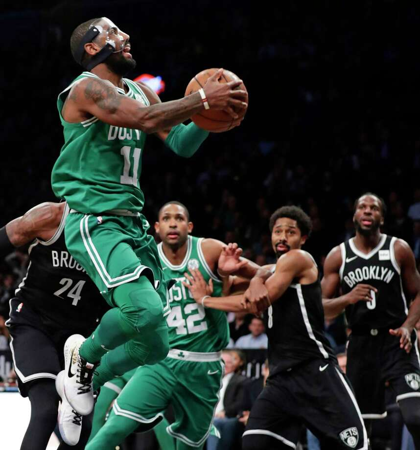 Boston Celtics' Kyrie Irving (11) drives to the basket during the second half of an NBA basketball game against the Brooklyn Nets on Tuesday, Nov. 14, 2017, in New York. The Celtics won 109-102. (AP Photo/Frank Franklin II) ORG XMIT: NYFF115 Photo: Frank Franklin II / Copyright 2017 The Associated Press. All rights reserved.