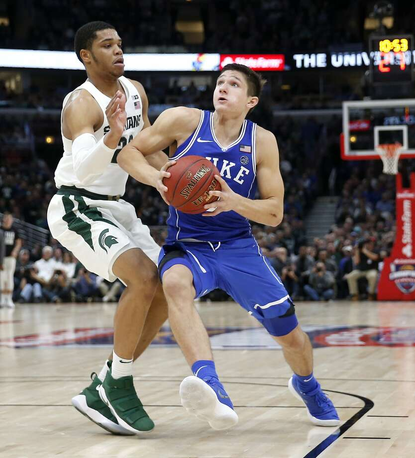 Duke guard Grayson Allen, right, drives past Michigan State guard Miles Bridges during the second half of an NCAA college basketball game Tuesday, Nov. 14, 2017, in Chicago. Duke won 88-81. (AP Photo/Charles Rex Arbogast) Photo: Charles Rex Arbogast, Associated Press