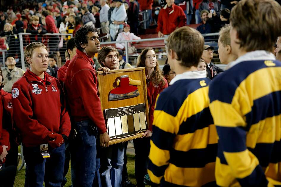 Stanford students display the STanford AXe to students from California's just before the end of the game as Stanford beat California 35-22 in the 118th Big Game at Stanford Stadium, on Sat. November 21, 2015, in Stanford, Calif.