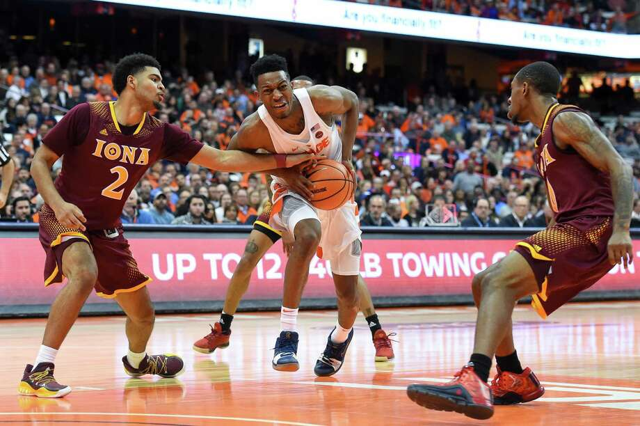 SYRACUSE, NY - NOVEMBER 14:  E.J. Crawford #2 of the Iona Gaels reaches to steal the ball from Tyus Battle #25 of the Syracuse Orange during the second half at the Carrier Dome on November 14, 2017 in Syracuse, New York. Syracuse defeated Iona 71-62. (Photo by Rich Barnes/Getty Images) ORG XMIT: 775059964 Photo: Rich Barnes / 2017 Getty Images