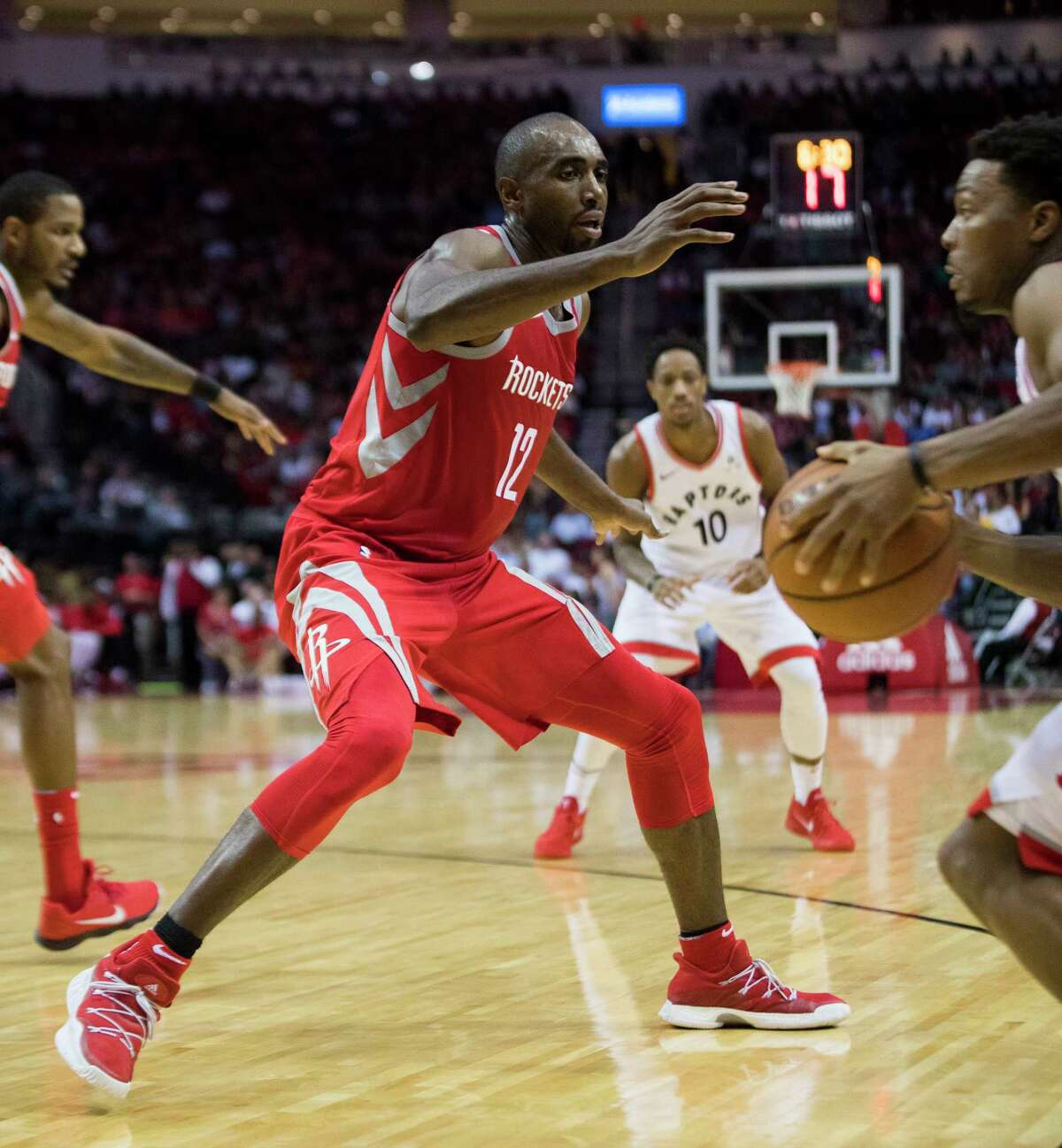 Houston Rockets forward Luc Mbah a Moute (12) put pressure on Toronto Raptors guard Kyle Lowry (7) during the second half of the game, Tuesday, Nov. 14, 2017, in Houston. The Toronto Raptors won 129-113.