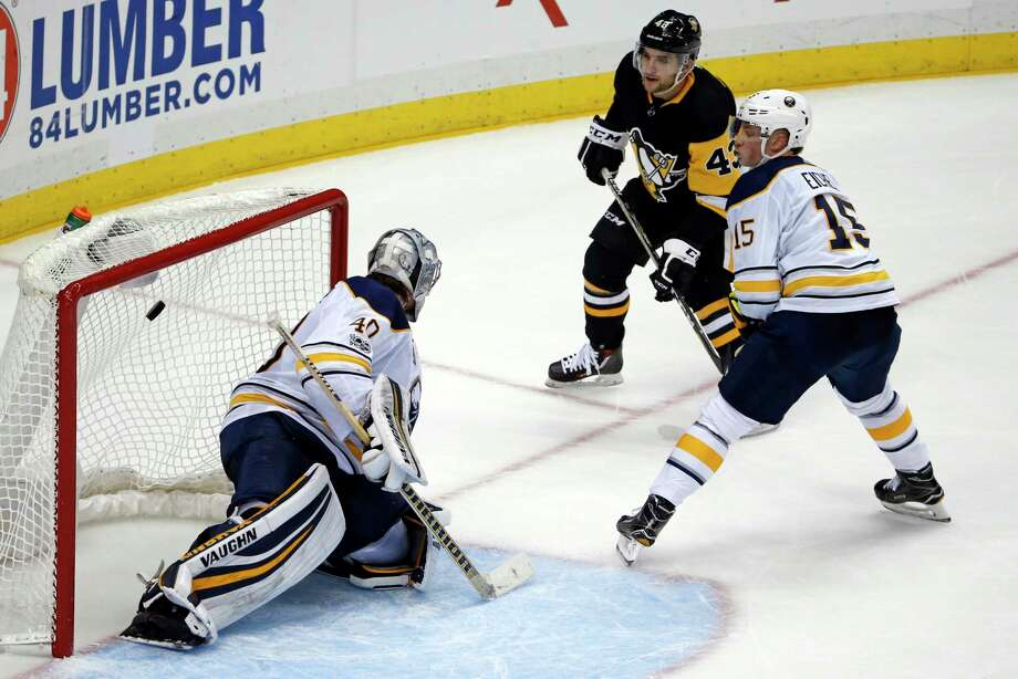 Pittsburgh Penguins' Conor Sheary (43) gets the game-winning overtime goal past Buffalo Sabres goalie Robin Lehner (40) with Jack Eichel (15) defending at the end of an NHL hockey game in Pittsburgh, Tuesday, Nov. 14, 2017. The Penguins won 5-4. (AP Photo/Gene J. Puskar) ORG XMIT: PAGP115 Photo: Gene J. Puskar / Copyright 2017 The Associated Press. All rights reserved.