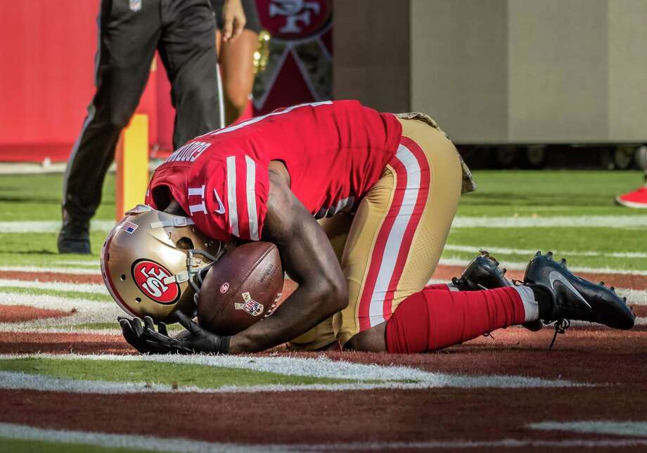 SANTA CLARA, CA - NOVEMBER 12: San Francisco 49ers wide receiver Marquise Goodwin (11) breaks down in grief after his touchdown run during the regular season game between the New York Giants verses the San Francisco 49ers on Sunday, November 12, 2017 at Levi's Stadium in Santa Clara, CA (Photo by Douglas Stringer/Icon Sportswire via Getty Images) Photo: Icon Sportswire / Icon Sportswire Via Getty Images / ©Icon Sportswire (A Division of XML Team Solutions) All Rights Reserved