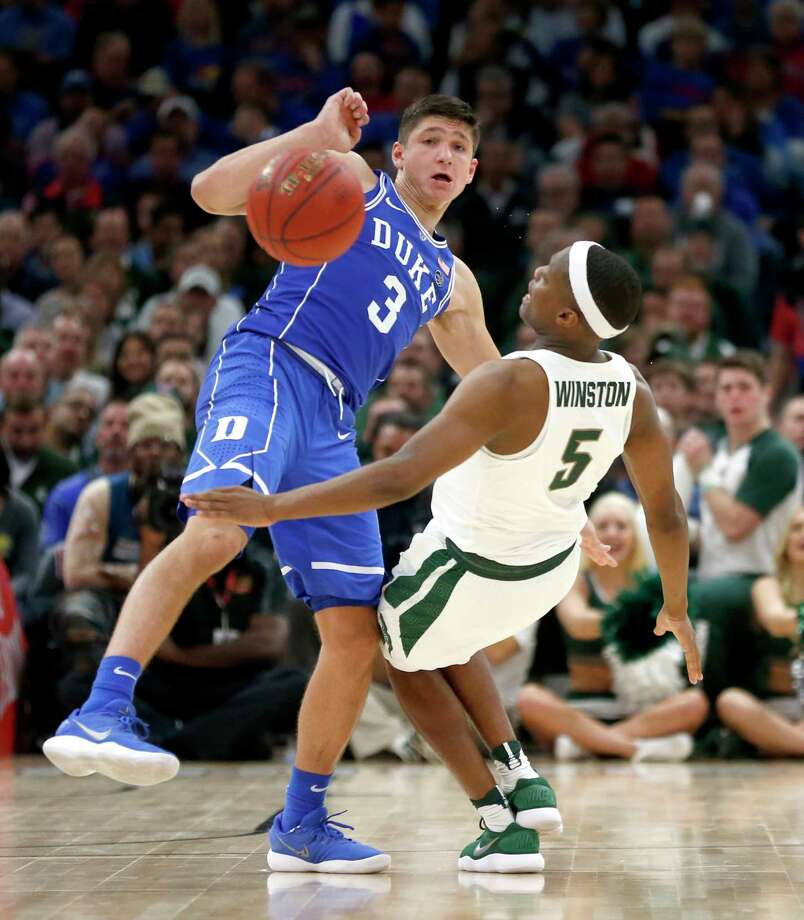 Duke guard Grayson Allen and Michigan State guard Cassius Winston collide during the second half of an NCAA college basketball game Tuesday, Nov. 14, 2017, in Chicago. Duke won 88-81. (AP Photo/Charles Rex Arbogast) ORG XMIT: CXA123 Photo: Charles Rex Arbogast / Copyright 2017 The Associated Press. All rights reserved.