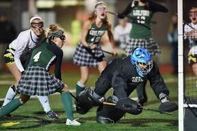 Hand's Erickson Richard battles Guilford's Mariah Cretella (4) and scores against goalkeeper Nicolette Spotlow in the second half of the Class M semifinals Tuesday at the James L. MacVeigh Alumni Athletic Complex at Branford High School.