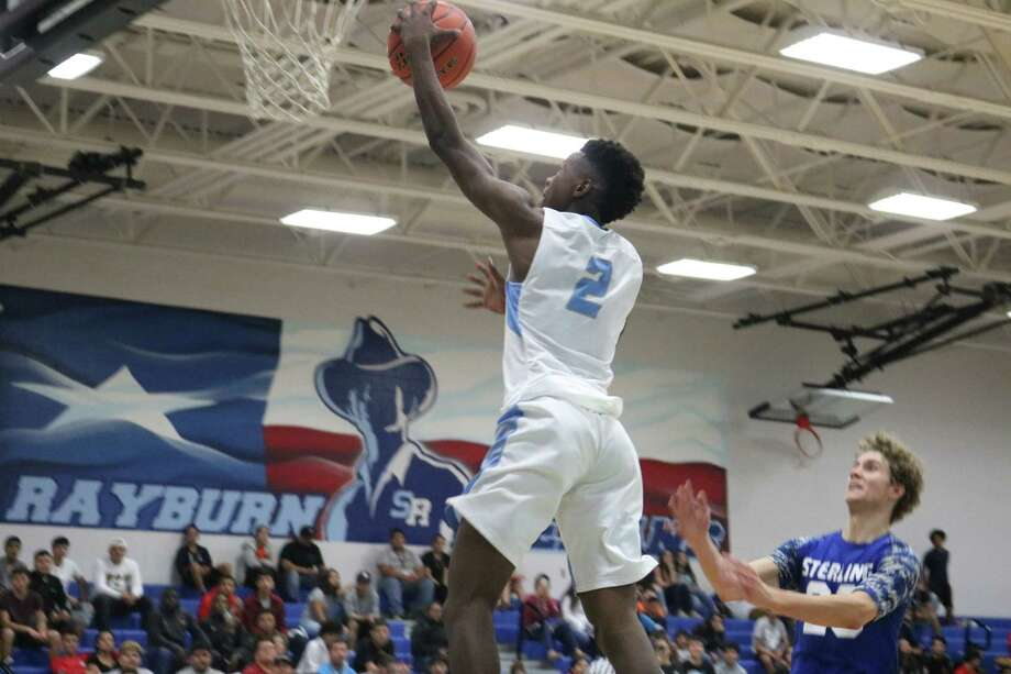 Rayburn's Deunte Walls drives to the bucket during first-half action Tuesday night. The Texans celebrated their season opener with a triple overtime loss. Photo: Robert Avery