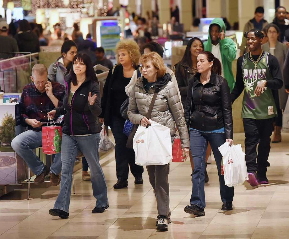 Shoppers hunt for bargains on Black Friday, November 25, 2016, at the Connecticut Post Mall in Milford. (Catherine Avalone/New Haven Register) Photo: Catherine Avalone / New Haven RegisterThe Middletown Press