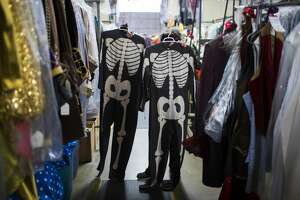 Terrie Frankel holds a pair of costumes made by the original owners of Frankel's Costume Company during the 1950s. Frankel and her husband are selling the iconic store. Tuesday, Nov. 14, 2017, in Houston. ( Marie D. De Jesus / Houston Chronicle )
