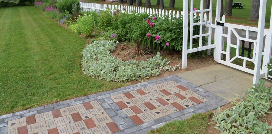 The first phase of the new memorial brick walkway in the garden at Harrybrooke Park & Harden House Museum in New Milford was dedicated this past summer. Photo: Deborah Rose / Hearst Connecticut Media / The News-Times  / Spectrum