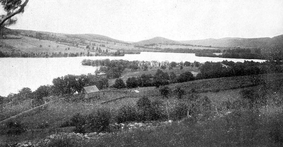 """This uncredited photo looking south over Lake Waramaug reveals a 19th century landscape, in the New Preston section of Washington across the lake and Warren in the foreground, nearly free of buildings save for the occasional farmhouse. If you have a """"Way Back When"""" photo to share, contact Deborah Rose at drose@newstimes.com or 860-355-7324. Photo: Contributed Photo / Contributed Photo / The News-Times Contributed"""