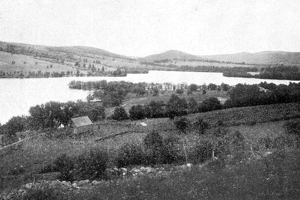 """This uncredited photo looking south over Lake Waramaug reveals a 19th century landscape, in the New Preston section of Washington across the lake and Warren in the foreground, nearly free of buildings save for the occasional farmhouse. If you have a """"Way Back When"""" photo to share, contact Deborah Rose at drose@newstimes.com or 860-355-7324."""