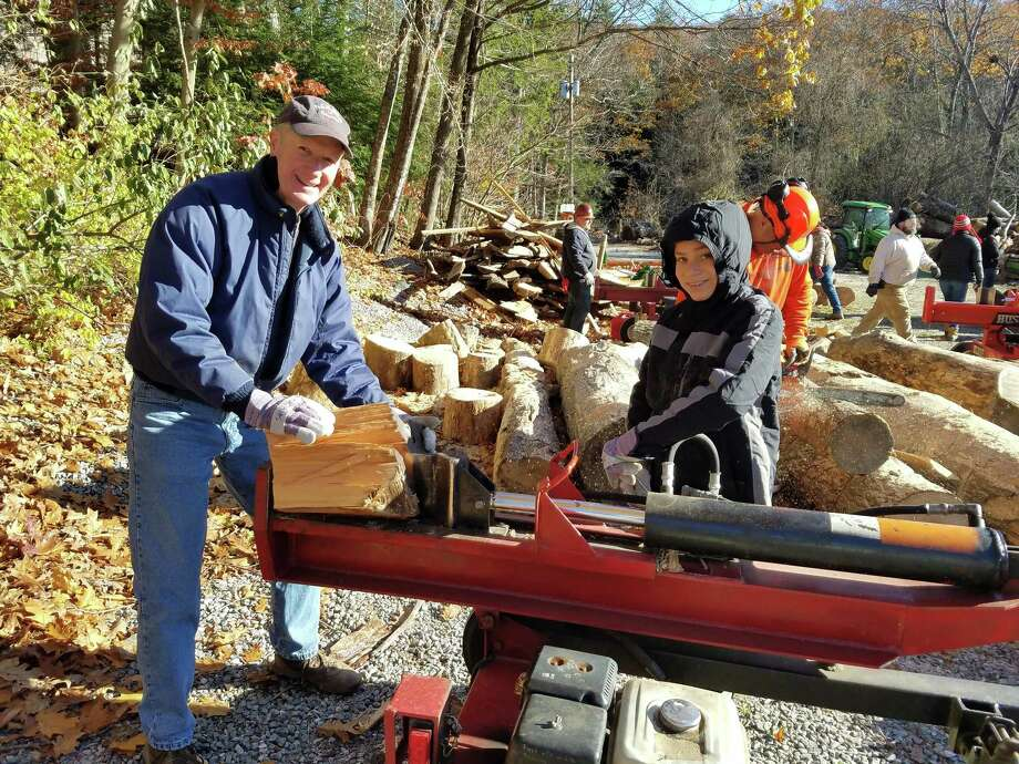 Mark and Nick Mathias using a log splitter at YMCA Camp Jewell in Colebrook, Connecticut on Saturday, Nov. 11. Photo: Contributed Photo