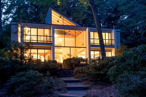 The contemporary house at 645 Springer Road sits along 151 feet of water frontage on Samp Mortar Lake.