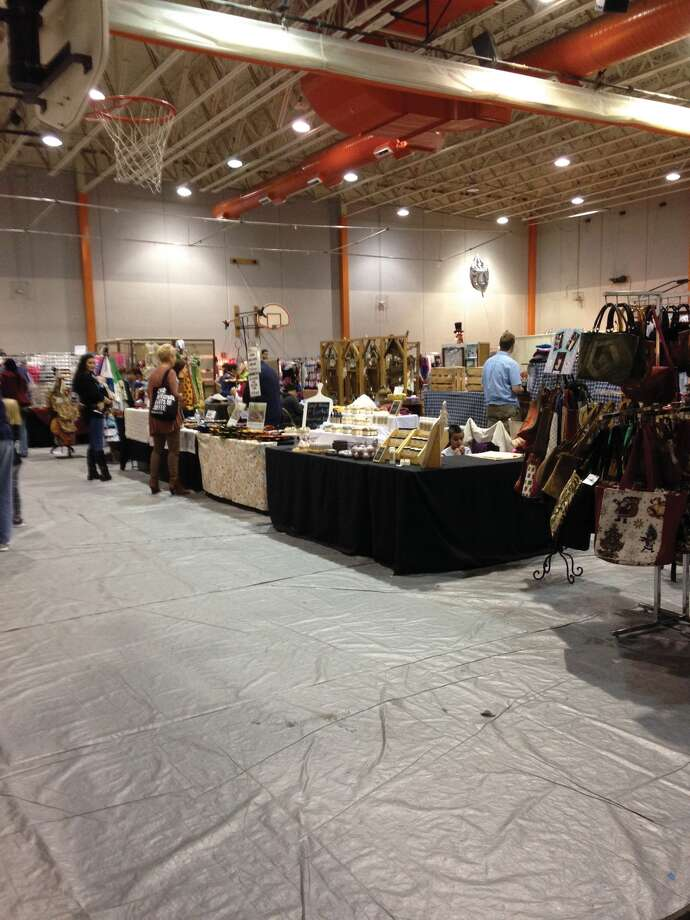 Shoppers browse the offerings Sunday during the Edwardsville High School Band Boosters' Annual Craft Fair. The fundraiser covered two days and booths were set up in Lucco-Jackson Gymnasium, Gym B, the EHS Commons and a handful of hallways. As always, the event drew a large crowd. Photo: Intelligencer Photo