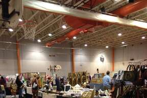 Shoppers browse the offerings Sunday during the Edwardsville High School Band Boosters' Annual Craft Fair. The fundraiser covered two days and booths were set up in Lucco-Jackson Gymnasium, Gym B, the EHS Commons and a handful of hallways. As always, the event drew a large crowd.