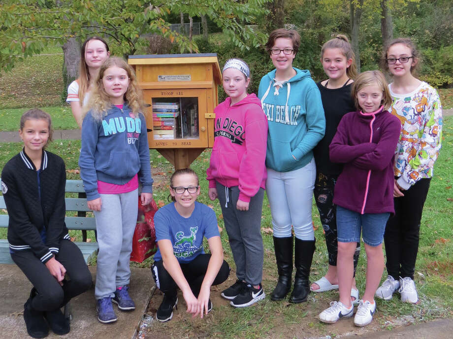 Girl Scout Troop 611 recently dedicated a Little Free Library at Miner Park in Glen Carbon. The cadet troop consists of 11- and 12-year-old girls from Edwardsville, Glen Carbon and Moro. They raised money for the library through cookie sales. Parents and grandparents made the library and installed it. Each girl in the troop will be assigned a month to maintain the library. The project is part of the girls' work toward a Junior Bronze Award. Photo: Carol Arnett • Carnett.edwi@gmail.com