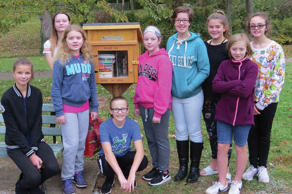 Girl Scout Troop 611 recently dedicated a Little Free Library at Miner Park in Glen Carbon. The cadet troop consists of 11- and 12-year-old girls from Edwardsville, Glen Carbon and Moro. They raised money for the library through cookie sales. Parents and grandparents made the library and installed it. Each girl in the troop will be assigned a month to maintain the library. The project is part of the girls' work toward a Junior Bronze Award.