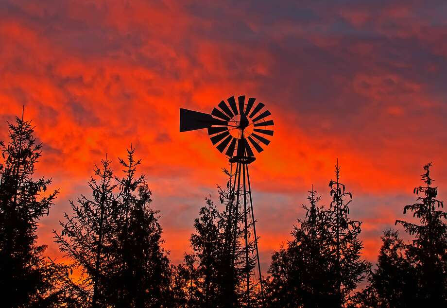 A beautiful autumn sunrise over a farm near Pigeon. Photo: Bill Diller/For The Tribune