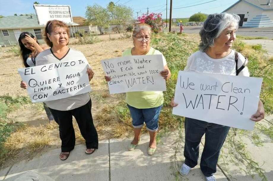 In this September 2013 file photo, Rio Bravo residents gather outside of the Webb County Water Treatment Plant to announce they would continue to boil their water after a boil water alert was lifted the week prior. Photo: LMTonline.com Staff